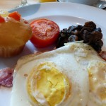 Bacon, eggs, and gluten-free muffin on Princess cruise ship.